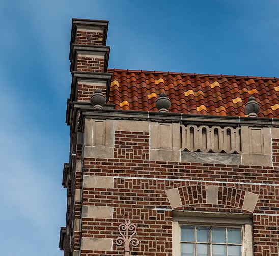 Top of a brick building against a blue sky