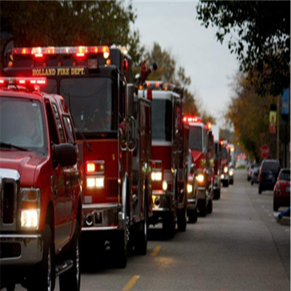 Parade line of Fire Trucks with lights on