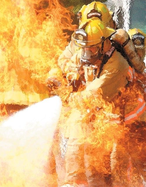 Fire Fighter putting out a fire