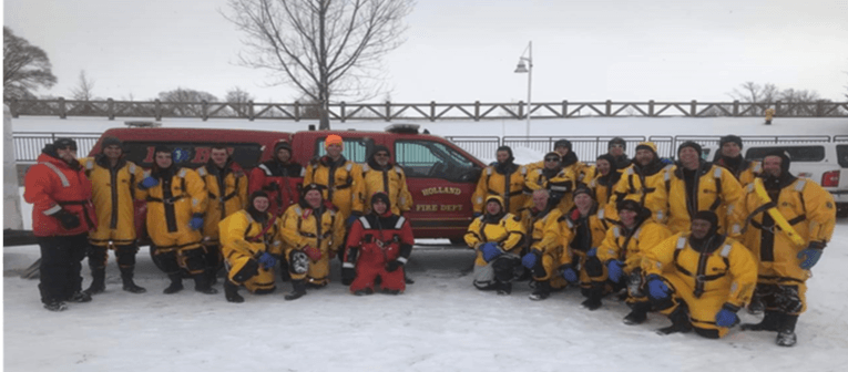 Ice Rescue Crew Standing in front of a Department truck